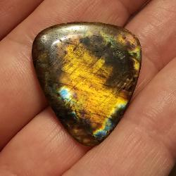 guitar pick carved from labradorite